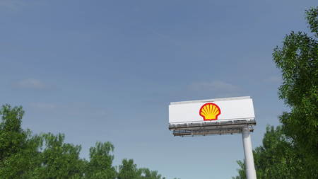 Driving towards advertising billboard with Shell Oil Company logo. Editorial 3D Editorial