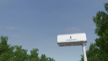 advertise with us: Driving towards advertising billboard with UnitedHealth Group logo. Editorial 3D