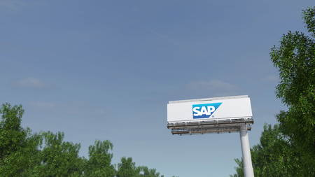 Driving towards advertising billboard with SAP SE logo. Editorial 3D Editorial