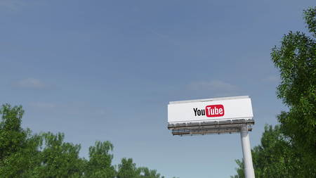 Driving towards advertising billboard with YouTube logo. Editorial 3D