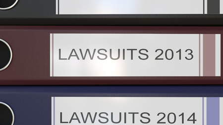 Vertical stack of multicolor office binders with Lawsuits tags 3D rendering different years
