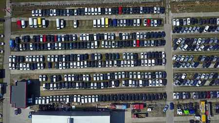 Aerial shot of new cars and trucks parking