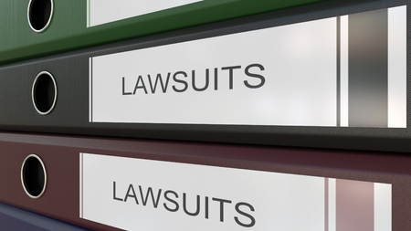 Office binders with Lawsuits tags 3D rendering Stock Photo