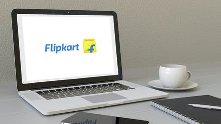 Laptop with Flipkart logo on the screen. Modern workplace conceptual editorial 3D rendering Éditoriale