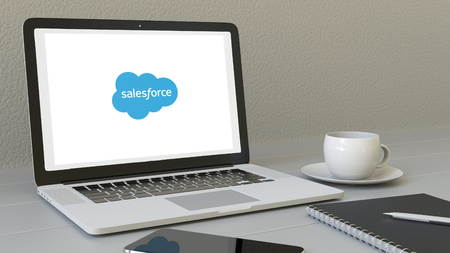 Laptop with Salesforce logo on the screen. Modern workplace conceptual editorial 3D rendering