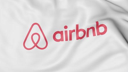 Airbnb 로고 깃발을 흔들며. Editorial 3D rendering