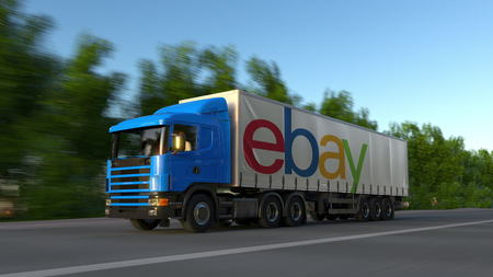 ebay: Freight semi truck with eBay Inc. logo driving along forest road. Editorial 3D rendering Editorial