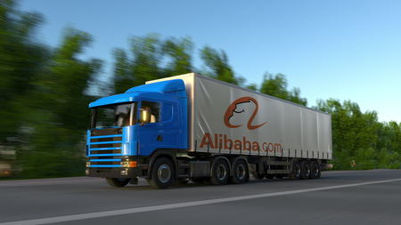 Freight semi truck with Alibaba.com logo driving along forest road. Editorial 3D rendering