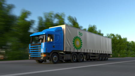 Freight semi truck with BP logo driving along forest road. Editorial 3D rendering