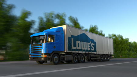 Freight semi truck with Lowes logo driving along forest road. Editorial 3D rendering