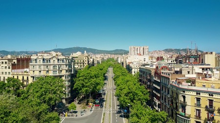 sagrada: Barcelona major street aerial view, Spain. Distant Sagrada Familia basilica to the right Stock Photo