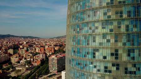Skyscraper details and Barcelona city aerial view on a sunny day, Spain