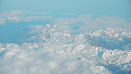 ridgeline: The Alps mountains and clouds, aeial view