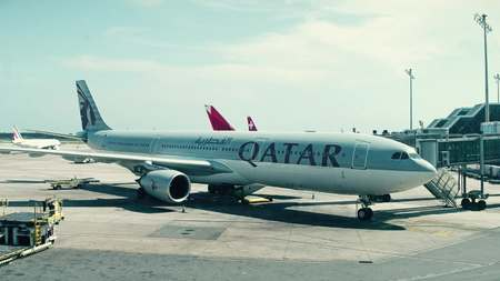 BARCELONA, SPAIN - APRIL, 15, 2017. Qatar Airways Airbus airliner boarding at the airport Editorial
