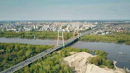 Aerial shot of Warsaw residential area, Vistula river and guyed bridge