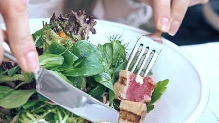 Eating tuna and lettuce Nicoise salad at the restaurant, haute cuisine