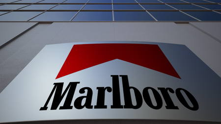 Outdoor signage board with Marlboro logo. Modern office building. Editorial 3D
