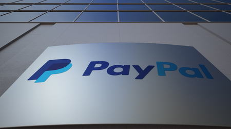 Outdoor signage board with PayPal logo. Modern office building. Editorial 3D