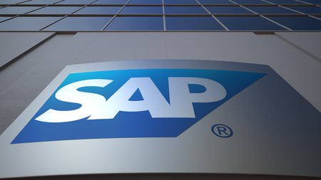 Outdoor signage board with SAP SE logo. Modern office building. Editorial 3D