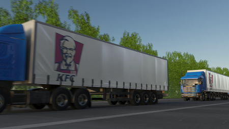 famous industries: Freight semi trucks with Kentucky Fried Chicken KFC logo driving along forest road. Editorial 3D rendering