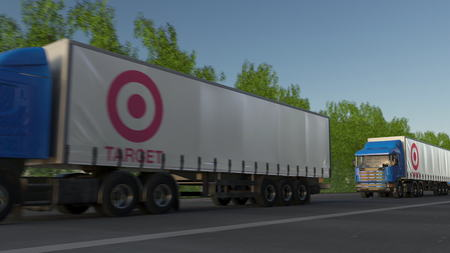 Freight semi trucks with Target Corporation logo driving along forest road. Editorial 3D rendering Editorial