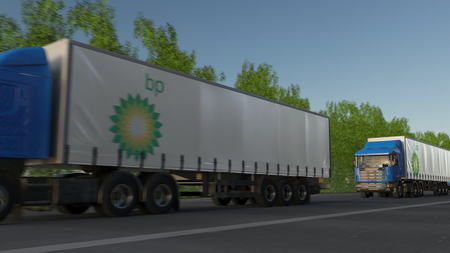 Freight semi trucks with BP logo driving along forest road. Editorial 3D rendering Editorial