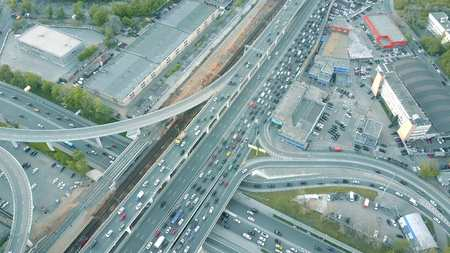 Aerial time lapse. Traffic jam on a car road in the rush hour