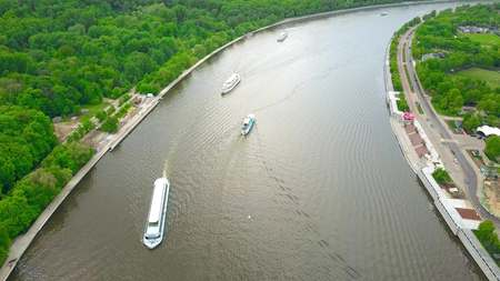Aerial shot of Moscow river tour boats near Vorobievy Gory recreation area