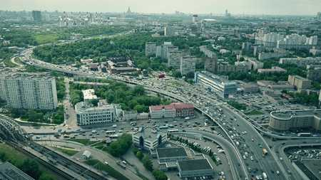 Aerial shot of Moscow cityscape and congested road traffic in the rush hour