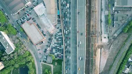 top down car: Aerial shot of heavy traffic jam on a car road in the rush hour