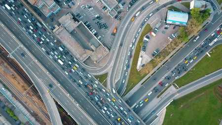 top down car: Aerial top down view of traffic jam on a city car road in the rush hour Stock Photo