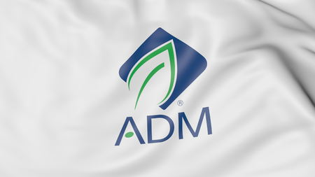 Waving flag with Archer Daniels Midland ADM logo. Editorial 3D rendering