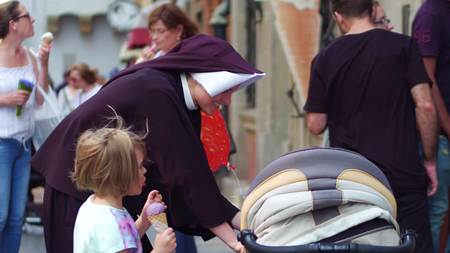monastic: WARSAW, POLAND - JUNE 10, 2017. Nun and small kids on the street Editorial