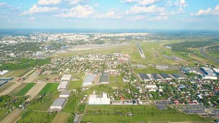 Aerial shot of Warsaw international airport and commercial airplane takeoff Фото со стока
