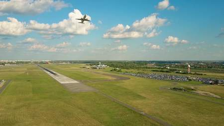 WARSAW, POLAND - JUNE 19, 2017. Aerial shot of LOT commercial airliner taking off and leaving Chopin international airport