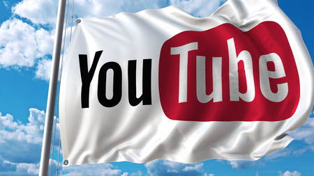 Waving flag with Youtube logo against sky and clouds. Editorial 3D rendering