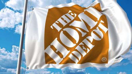 Waving flag with The Home Depot logo against sky and clouds. Editorial 3D rendering
