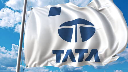 Waving flag with Tata logo against sky and clouds. Editorial 3D rendering