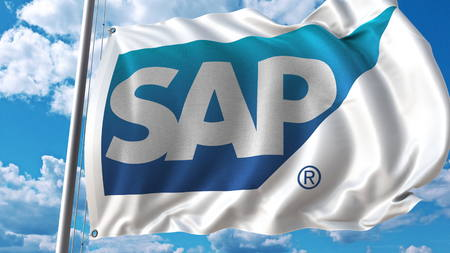 Waving flag with SAP logo against sky and clouds. Editorial 3D rendering