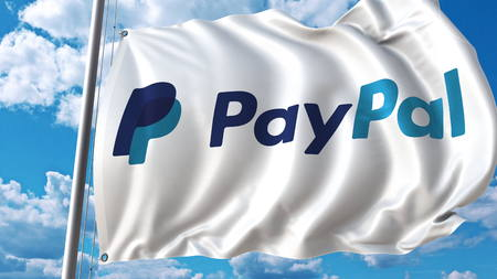 Waving flag with Paypal logo against sky and clouds. Editorial 3D rendering