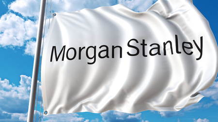 Waving flag with Morgan Stanley logo against sky and clouds. Editorial 3D rendering