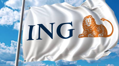 Waving flag with ING logo against sky and clouds. Editorial 3D rendering Banco de Imagens - 80800246