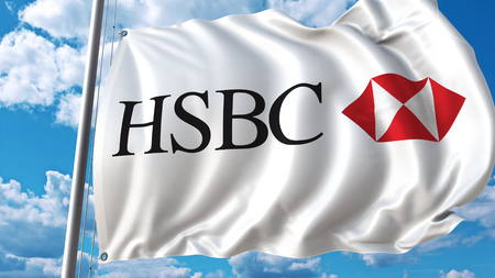 Waving flag with HSBC logo against sky and clouds. Editorial 3D rendering Editorial