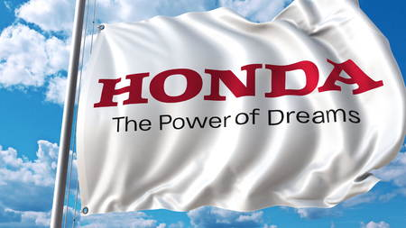 Waving flag with Honda logo against sky and clouds. Editorial 3D rendering