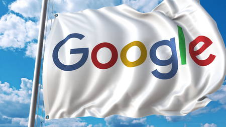 Waving flag with Google logo against sky and clouds. Editorial 3D rendering