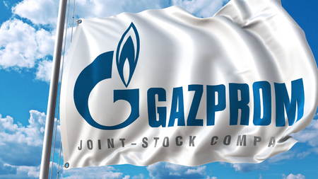 Waving flag with Gazprom logo against sky and clouds. Editorial 3D rendering