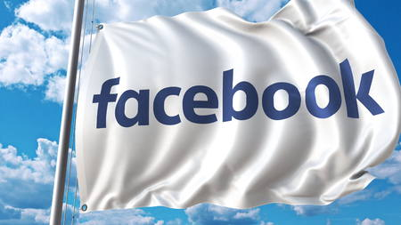Waving flag with Facebook logo against sky and clouds. Editorial 3D rendering Editorial