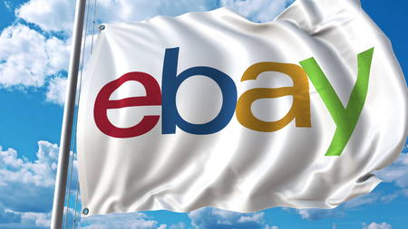 Waving flag with Ebay logo against sky and clouds. Editorial 3D rendering