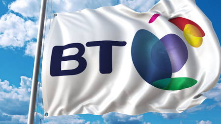 Waving flag with British Telecom BT logo against sky and clouds. Editorial 3D rendering