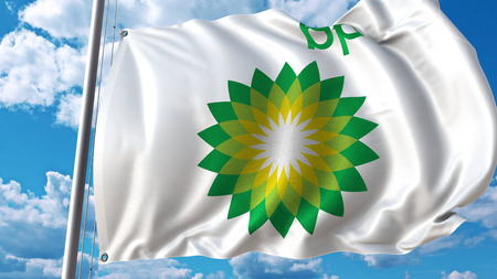 Waving flag with BP logo against sky and clouds. Editorial 3D rendering Editorial